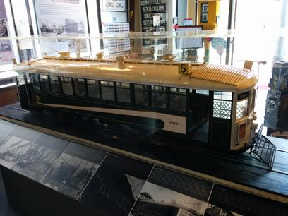 A 1:8 scale model of a streetcar on display in the San Francisco Railway Museum